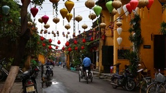 Vietnam, Hoi An -Tourists strolling through the streets of Hoi An Stock Footage