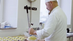 Man presses the dough in special form Stock Footage