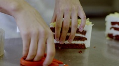 Woman wraps a slice of cake Stock Footage