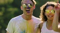 Young attractive people hugging, dancing at open-air Color festival, slow motion HD Footage