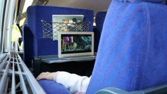 Modern kid traveling in fast train watching movie on laptop Stock Footage