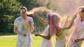 Playful fight between two couples at Color fest, friends having fun, slow motion HD Footage
