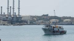 MARSAXLOKK, MALTA - Fishing boats in the harbour Stock Footage