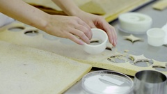 Round circles are cut in the ready dough by a human hand Stock Footage