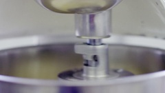 Mixer machine is whipping the cream, doing circular motions Stock Footage