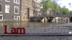 I amsterdam slogan and city view in background, Netherlands Stock Footage