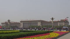 Tourist people visit Tiananmen Square and Great Hall building in Beijing asian Stock Footage