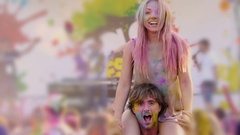Smiling girl sitting on tall guy's shoulders, dancing and having fun at concert Stock Footage