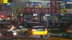 Crowded Wangfujing street by night heavy traffic car Beijing commercial district Stock Footage