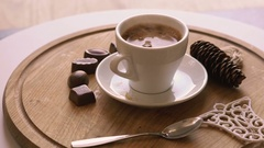 Close up rotating wooden background with coffee, candies and biscuit Stock Footage