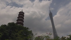 Modern Canton Tower and traditional pagoda in Guangzhou Six Banyan Trees temple Stock Footage