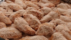 Buffalo wings rolled in dough and spiced close up Stock Footage