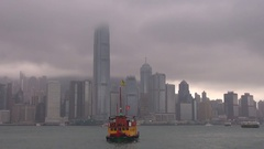 Beautiful boat sail on Hong Kong river popular sightseeing in cloudy day emblem Stock Footage