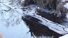 Spring creek melting snow, shore river covered with ice and snow, air bubbles Stock Footage