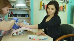 Hardware manicure, nail care beautiful woman in beauty salon. Manicure varnish Stock Footage