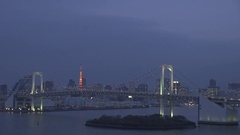 Traffic car on Rainbow Bridge in Tokyo Odaiba downtown city touristic tower icon Stock Footage