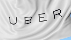 Close-up of waving flag with Uber Technologies Inc. logo, seamless loop, blue Stock Footage