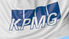 Close-up of waving flag with KPMG logo, seamless loop, blue background Arkistovideo
