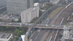 Aerial view public transportation din crowded Tokyo downtown modern train travel Stock Footage