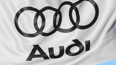 Close-up of waving flag with Audi logo, seamless loop, blue background Stock Footage