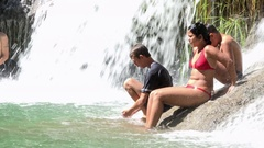 Cuban real people swimming in El Nicho river waterfall in Summer- Cuba Nature Stock Footage