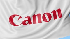 Close-up of waving flag with Canon Inc. logo, seamless loop, blue background Stock Footage