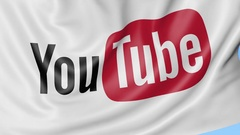 Close-up of waving flag with YouTube logo, seamless loop, blue background Stock Footage