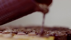 The process of covering cakes with chocolate glaze Stock Footage