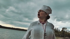 Medic and start yelling at lake on summer cloudy day Stock Footage