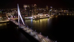 Timelapse of car traffic on Erasmus Bridge in night Rotterdam Stock Footage