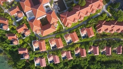 Flying above luxury hotel complex beachfront villas with perfect exotic location Stock Footage