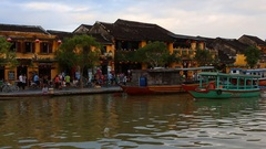 Vietnam, Hoi An -  Pleasure boat floats on Bon River  in Hoi An Stock Footage