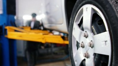 Wgite car in auto service lifting for repairing, slider Stock Footage