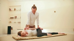 Traditional thai massage therapy - impact on shoulders for caucasian female Stock Footage