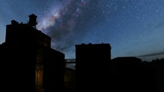 Buildings of old town and Milky Way stars at night.  Stock Footage