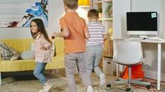 Happy Children Running Around Room Stock Footage