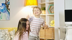 Little Children Jumping Up and Down Stock Footage