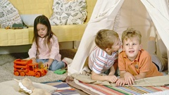 Little Boys Gossiping in Teepee Stock Footage
