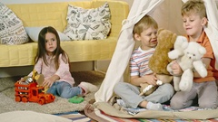 Children Playing with Toys in Teepee Stock Footage