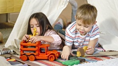 Little Girl and Boy Playing with Toys Stock Footage