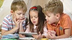 Little Children Watching Movie on Tablet Stock Footage