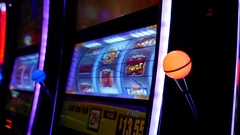 Motion of slot machine with lights glowing in the dark inside Hard Rock Casino. Stock Footage