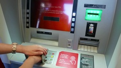 Woman changing pin number at ATM machine with 4k resolution Stock Footage