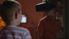 Boy in VR Headset Talking with Friend Stock Footage