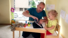 Father take tablet computer from his child girl and walk away Stock Footage