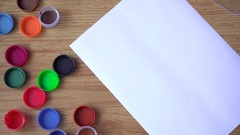 The artist draws a green paint on a sheet of paper Stock Footage