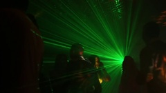 Young people dancing at a party spotlight and lasers Stock Footage