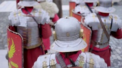 Roman legionaries column dressed in armor that marches and that stops to thei Stock Footage