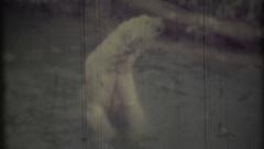 Polar bear swimming in water. 8mm retro video. Stock Footage