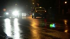 Car traffic on a wet asphalt road rain overnight Stock Footage